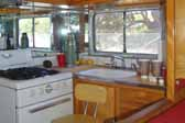 Photo of galley area and original gas stove in a 1950 Vagabond travel trailer