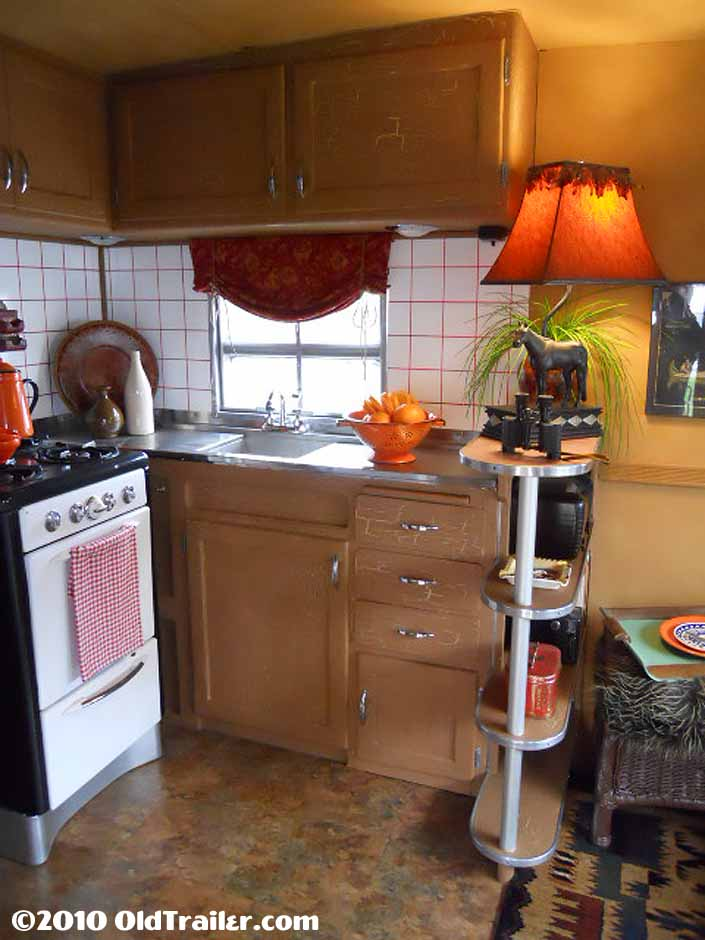 This vintage 1950 vagabond trailer has a beautifully restored kitchen