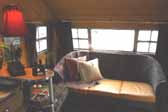 Photo of the living room area in the front of a 1950 Vagabond trailer