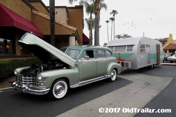 This vintage towing rig is a 1941 Cadillac limo pulling a 1951 spartanette tandem vintage trailer