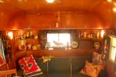 Photo shows the cozy sofa in a 1951 Vagabond trailer living room