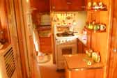 Picture of the gorgeous interior cabinetry in a restored 1951 Vagabond trailer