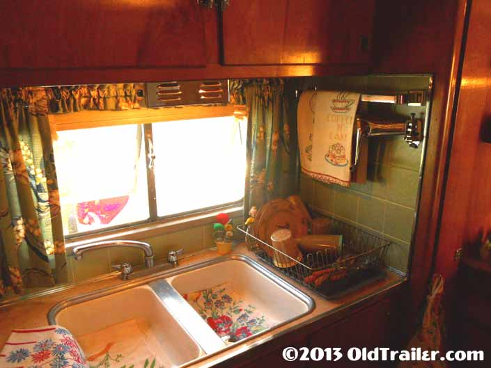Restored 1951 Vagabond vintage trailer with a side galley area