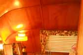 Photo shows the cozy rear bedroom in a vintage 1951 Vagabond trailer