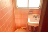 Photo of the original pink bathroom tile in a restored 1951 Vagabond trailer