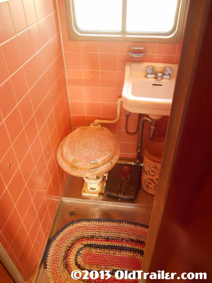This restored 1951 Vagabond trailer has original pink tile in the bathroom