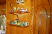 Classic curios shelves for knick knacks in a 1951 Vagabond trailer