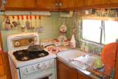 Picture of mint green walls in the kitchen area of a 1951 Vagabond trailer
