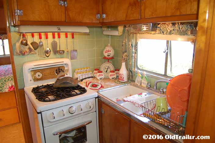 This 1951 Vagabond trailer has mint green tiles in the kitchen area