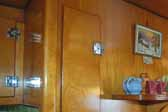 Photo of the restored interior cabinets in a 1951 Vagabond travel trailer