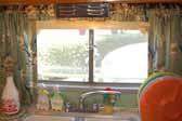Side window over kitchen sink in a restored 1951 Vagabond trailer