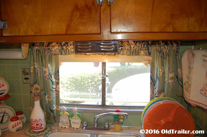 Photo shows restored 1951 Vagabond trailer side window over the kitchen sink