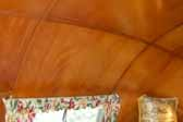 Photo shows beautiful curved ceiling panels in a 1951 Vagabond trailer bedroom