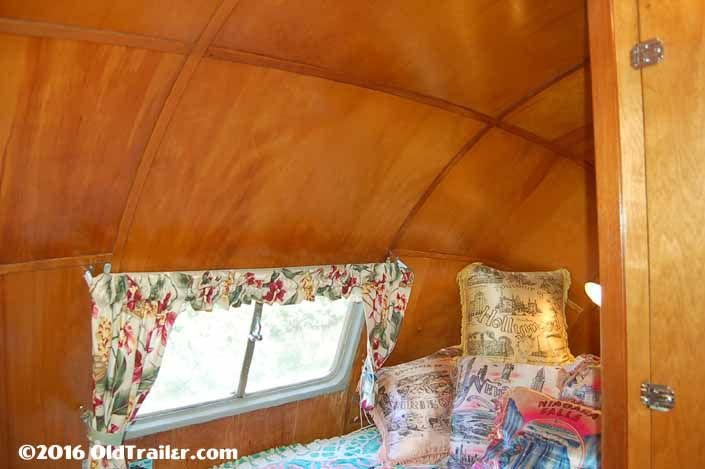 This 1951 Vagabond trailer has beautiful curved ceiling panels in the bedroom