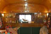 Picture of curio shelves in the front living room of a 1951 Vagabond trailer