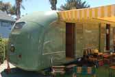 Photo shows the rear bedroom door in a vintage 1951 Vagabond trailer