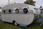 Rare 1952 Airfloat vintage trailer with corrugated aluminum siding above and below porthole windows