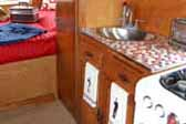 1952 Airfloat trailer has new kitchen sink and faucets and small square mosiac tiled countertop