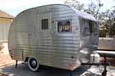 Photo of a classic 1953 Sportcraft by Aljoa canned ham trailer