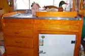 Perfectly restored birch kitchen cabinet in a 1953 Aljoa trailer