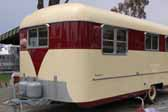 Photo shows the front end view of a 1953 Vagabond vintage trailer