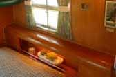 Photo shows 1955 Aljoa Sportsman trailer with awesome wood rounded headboard in bedroom area