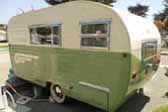Photo of side view of restored vintage 1955 Aljoa Sportsman Trailer