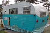 1955 Aljoa Canned Ham Trailer painted in turquoise and white 2-tone paint scheme