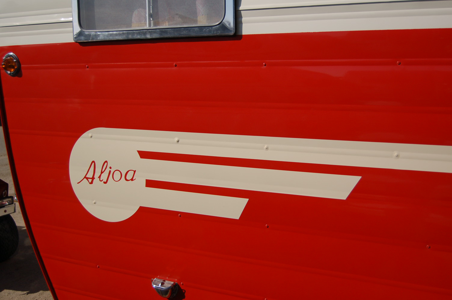 Striking Aljoa Logo Painted On The Side Of A Vintage 1955 Trailer
