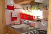 Beautifully decorated kitchen in 1955 vintage Aljoa trailer