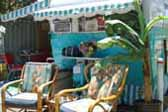 Beautiful 1955 Aljoa Trailer with restored Hawaiian bamboo upholstered arm chairs