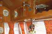 Bench seats upholstered in yellow and red in 1955 Shasta Trailer dining area
