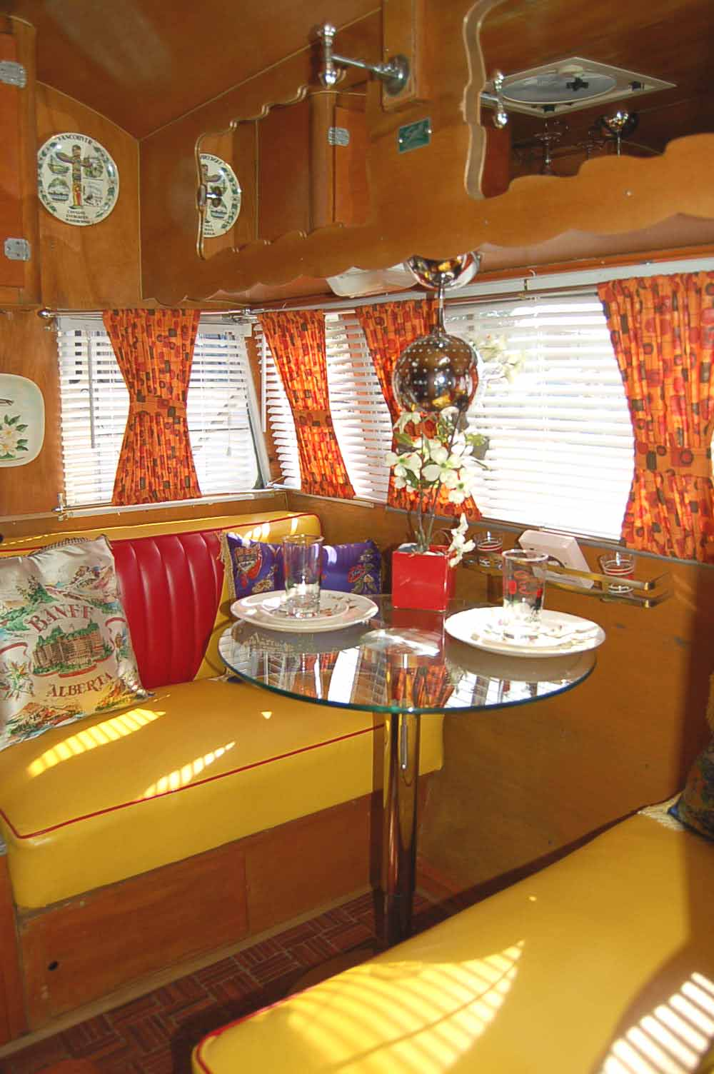 Bench Seats Upholstered In Yellow And Red 1955 Shasta Trailer Dining Area
