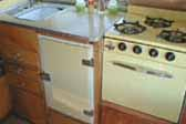 1955 Shasta Trailer with beautiful yellow countertop, fridge and Princess gas oven