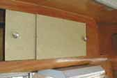 Picture of original laminate sliding cabinet doors in 1955 Shasta Trailer