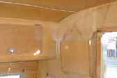 Photo shows birch wall and ceiling paneling in vintage 1955 Shasta Trailer