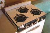 Cool black and white porcelain finish on 1955 Shasta Trailer gas stove