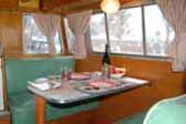 Picture shows very original dining area and upholstered bench seats in 1955 Shasta Trailer