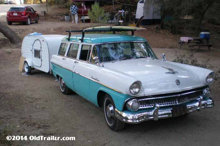 This vintage towing rig is a vintage 1956 ford country sedan pulling a vintage tear drop trailer