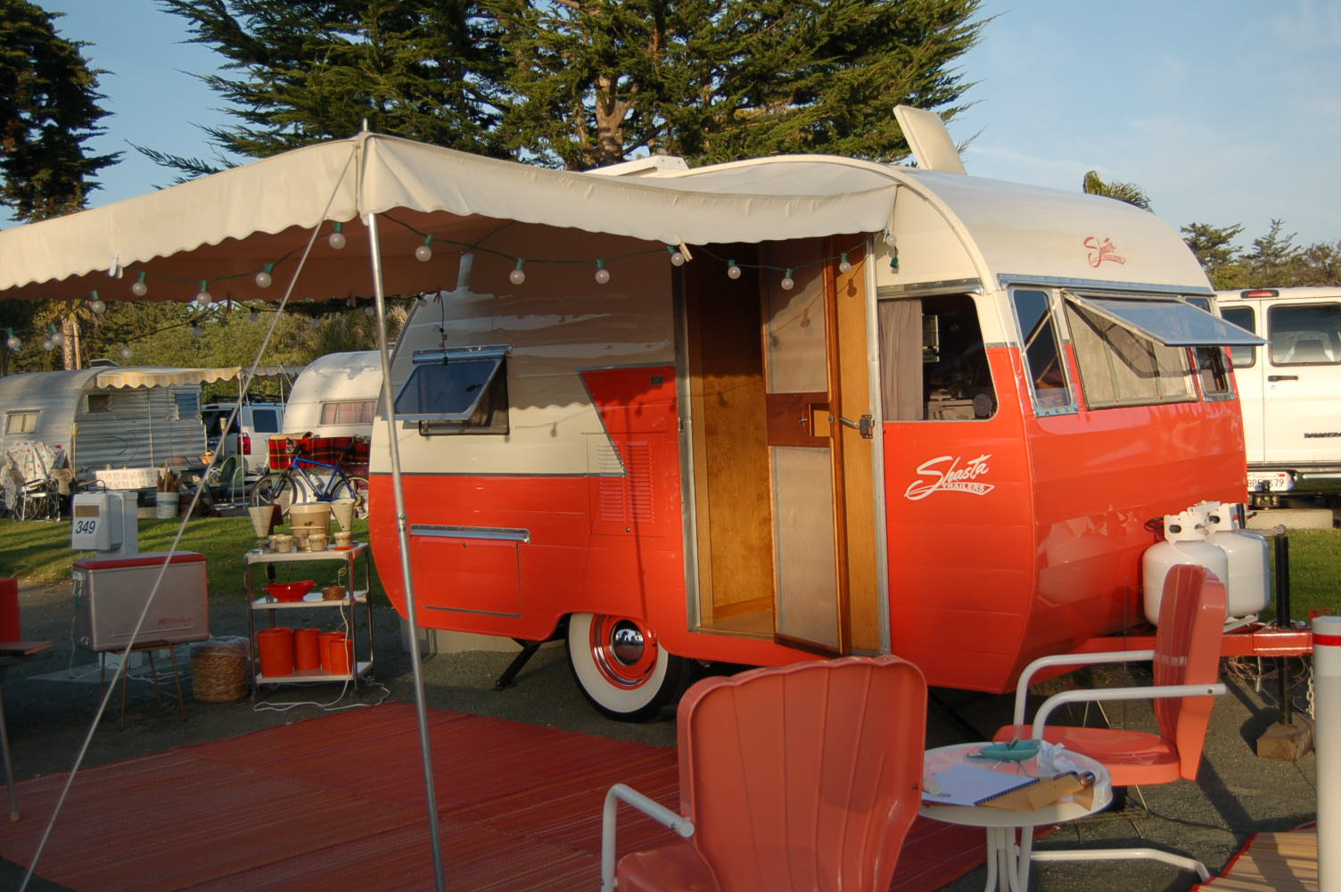 Elegant beige canvas awning with small scallop edging on a restored 1956 shasta 1400 trailer