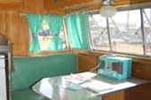 Original 1956 Shasta Trailer dining area decorated in green and white