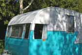 Bright 1956 Shasta 1400 Vintage Trailer ready for camping