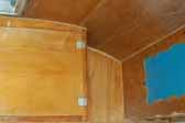 Birch wood cabinets and paneling in 1956 Shasta 1400 Travel Trailer