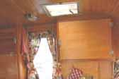 Beautifully finished birch ceiling paneling in 1956 Shasta trailer