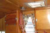 Perfect varnish job shows amazing wood grain on cabinets in 1956 Shasta Trailer