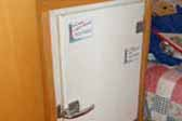 Photo of vintage white refrigerator installed in 1956 Shasta Travel Trailer