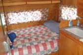 Retro patchwork quilt bedspread in 1956 Shasta Trailer