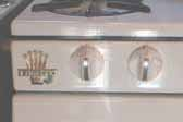 Close-up photo of Princess gas stove front panel in 1956 Shasta Trailer