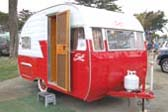 Very sharp 1956 Shasta Travel Trailer with vintage wide whitewall tires