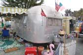 Cool 1957 Airstream Flying Cloud Trailer With Fun Accessories at The Beach